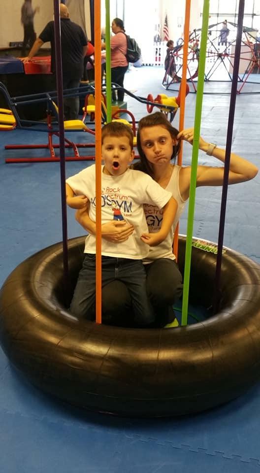 Marissa and kid tire swing